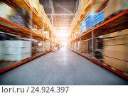 Купить «Long shelves with a variety of boxes and containers», фото № 24924397, снято 13 декабря 2016 г. (c) Андрей Радченко / Фотобанк Лори