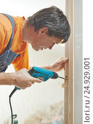 Купить «Carpenter works with drill», фото № 24929001, снято 15 августа 2014 г. (c) Дмитрий Калиновский / Фотобанк Лори