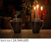 Купить «Two mugs of hot black coffee on a background of a New Year's interior and candles. Drink hot. Holiday Christmas concept. Cozy, fabulous, magical atmosphere. Evening, twilight», фото № 24944685, снято 14 ноября 2019 г. (c) Ирина Козорог / Фотобанк Лори