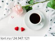 Купить «St Valentines day background - cup of coffee, rose, blank love card and two red heart shaped candies», фото № 24947121, снято 24 января 2017 г. (c) Зезелина Марина / Фотобанк Лори
