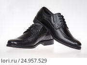 Black men's leather shoes. Стоковое фото, фотограф Станислав Занегин / Фотобанк Лори