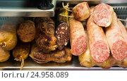 smoked sausage on counter. Стоковое фото, фотограф Яков Филимонов / Фотобанк Лори