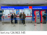 Купить «Currency Exchange at Vaclav Havel Airport Prague in Prague city, Czech Republic.», фото № 24963145, снято 2 октября 2015 г. (c) age Fotostock / Фотобанк Лори