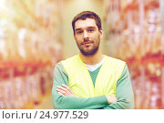 Купить «happy man in reflective safety vest at warehouse», фото № 24977529, снято 9 декабря 2015 г. (c) Syda Productions / Фотобанк Лори