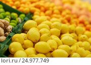 Купить «lemons at grocery store or market», фото № 24977749, снято 2 ноября 2016 г. (c) Syda Productions / Фотобанк Лори