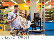 Купить «couple buying food at grocery at cash register», фото № 24978081, снято 21 октября 2016 г. (c) Syda Productions / Фотобанк Лори