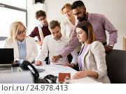 Купить «business team discussing house project at office», фото № 24978413, снято 1 октября 2016 г. (c) Syda Productions / Фотобанк Лори