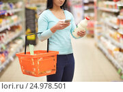 Купить «woman with smartphone buying milk at supermarket», фото № 24978501, снято 2 ноября 2016 г. (c) Syda Productions / Фотобанк Лори