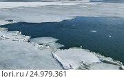Купить «Cracked ice floating on the river in spring time», видеоролик № 24979361, снято 13 мая 2016 г. (c) Михаил Коханчиков / Фотобанк Лори