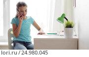 Купить «smiling girl calling on smartphone at home», видеоролик № 24980045, снято 11 ноября 2016 г. (c) Syda Productions / Фотобанк Лори