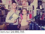 Купить «Couple choosing erotic toys», фото № 24980705, снято 23 марта 2019 г. (c) Яков Филимонов / Фотобанк Лори
