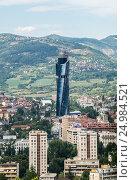 Aerial view from Vraca Memorial Park on Sarajevo city with Avaz Twist Tower skyscraper, Bosnia and Herzegovina. Стоковое фото, фотограф Konrad Zelazowski / age Fotostock / Фотобанк Лори