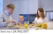 Купить «Families with a child at home», видеоролик № 24992097, снято 25 мая 2020 г. (c) Raev Denis / Фотобанк Лори