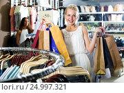 Купить «Girl having shopping paper bags in hands», фото № 24997321, снято 30 мая 2020 г. (c) Яков Филимонов / Фотобанк Лори