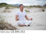 Купить «Mature man doing meditation», фото № 24999353, снято 29 сентября 2016 г. (c) Wavebreak Media / Фотобанк Лори