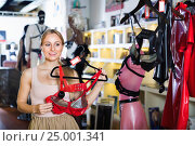 Portrait of adult girl choosing erotic lingerie. Стоковое фото, фотограф Яков Филимонов / Фотобанк Лори