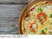 Купить «Italian pizza served on a pizza tray», фото № 25003777, снято 30 сентября 2016 г. (c) Wavebreak Media / Фотобанк Лори