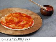 Купить «Pizza dough with tomato sauce», фото № 25003977, снято 30 сентября 2016 г. (c) Wavebreak Media / Фотобанк Лори