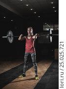 Купить «Cute blonde girl lifting barbell with weights», фото № 25025721, снято 11 сентября 2016 г. (c) Pavel Biryukov / Фотобанк Лори