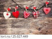Купить «Valentines Day Hearts on wooden background. Vintage style, toned, soft focus. Valentine day concept.», фото № 25027449, снято 2 января 2016 г. (c) Laimdota Grivane / Фотобанк Лори