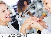 Купить «Female doing manicure», фото № 25029489, снято 2 ноября 2016 г. (c) Яков Филимонов / Фотобанк Лори