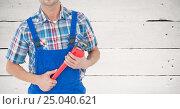 Mid section of handy man holding wrench. Стоковое фото, агентство Wavebreak Media / Фотобанк Лори