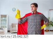 Купить «Super hero cleaner working at home», фото № 25042321, снято 22 декабря 2016 г. (c) Elnur / Фотобанк Лори