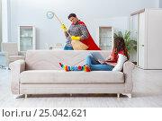 Купить «Superhero husband helping his wife at home», фото № 25042621, снято 26 декабря 2016 г. (c) Elnur / Фотобанк Лори