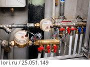 Купить «Установленный комплект счетчиков расхода воды», фото № 25051149, снято 2 декабря 2012 г. (c) Orion34 / Фотобанк Лори