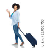 Купить «happy woman with travel bag waving hand», фото № 25056753, снято 17 декабря 2016 г. (c) Syda Productions / Фотобанк Лори