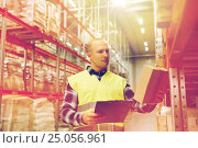 Купить «man with clipboard in safety vest at warehouse», фото № 25056961, снято 9 декабря 2015 г. (c) Syda Productions / Фотобанк Лори