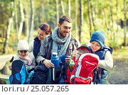 Купить «happy family with backpacks and thermos at camp», фото № 25057265, снято 27 сентября 2015 г. (c) Syda Productions / Фотобанк Лори