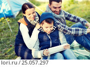 Купить «happy family with tablet pc and tent at camp site», фото № 25057297, снято 27 сентября 2015 г. (c) Syda Productions / Фотобанк Лори