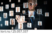 Купить «businessman touching screen with contact icons», фото № 25057337, снято 6 сентября 2016 г. (c) Syda Productions / Фотобанк Лори
