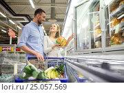 Купить «couple with shopping cart buying food at grocery», фото № 25057569, снято 21 октября 2016 г. (c) Syda Productions / Фотобанк Лори