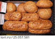 Купить «close up of bread at bakery or grocery store», фото № 25057581, снято 2 ноября 2016 г. (c) Syda Productions / Фотобанк Лори