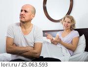 Купить «Mature couple having quarrel in bedroom», фото № 25063593, снято 22 ноября 2018 г. (c) Яков Филимонов / Фотобанк Лори