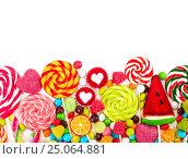 Купить «Colorful candies and lollipops. Top view.», фото № 25064881, снято 1 февраля 2017 г. (c) Наталия Пыжова / Фотобанк Лори