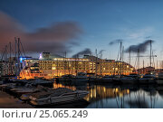 Gibraltar, an overseas territory of the UK. October 3, 2014.  Hotel Sunborn Gibraltar at night. View from the harbor. Редакционное фото, фотограф Анастасия Богатова / Фотобанк Лори