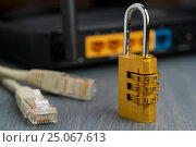 The concept of electronic security. Data encryption. wi-fi router in the background., фото № 25067613, снято 5 февраля 2017 г. (c) Александр Якимов / Фотобанк Лори