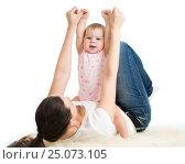Купить «Mother and baby gymnastics, yoga exercises», фото № 25073105, снято 13 декабря 2013 г. (c) Оксана Кузьмина / Фотобанк Лори