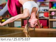 Купить «AntiGravity yoga in the fitness room», фото № 25075037, снято 15 октября 2015 г. (c) mauritius images / Фотобанк Лори