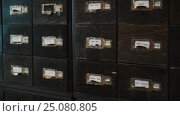 Купить «Dolly shot old archive wooden case boxes with labels numbers and russian text», видеоролик № 25080805, снято 11 октября 2016 г. (c) Александр Багно / Фотобанк Лори