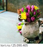 Купить «Beautiful spring tulips bouquet, easter eggs and garden tools», фото № 25090405, снято 18 февраля 2016 г. (c) Наталия Кленова / Фотобанк Лори