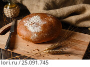 Rural rye bread lies on a table. Стоковое фото, фотограф Максим Стриганов / Фотобанк Лори