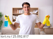 Купить «Man husband cleaning the house helping wife», фото № 25092817, снято 27 октября 2016 г. (c) Elnur / Фотобанк Лори