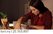 Купить «student girl or woman reading book at night home», видеоролик № 25103897, снято 16 декабря 2016 г. (c) Syda Productions / Фотобанк Лори