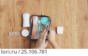 Купить «hands packing cosmetic bag for travel», видеоролик № 25106781, снято 13 января 2017 г. (c) Syda Productions / Фотобанк Лори