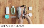 Купить «hands packing cosmetic bag for travel», видеоролик № 25106929, снято 13 января 2017 г. (c) Syda Productions / Фотобанк Лори