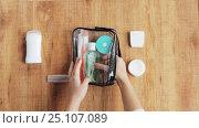 Купить «hands packing cosmetic bag for travel», видеоролик № 25107089, снято 13 января 2017 г. (c) Syda Productions / Фотобанк Лори